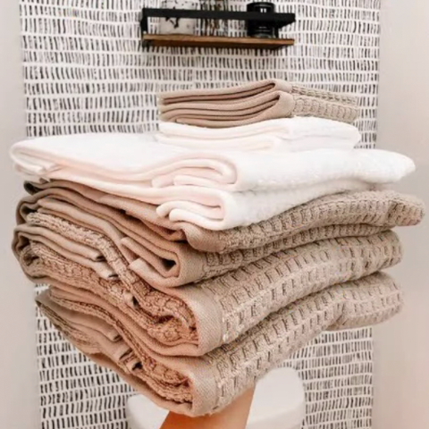 Stack of fresh, soft DKNY Quick Dry towels.