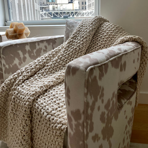 The DKNY PURE Chunky knit throw adds to any look!