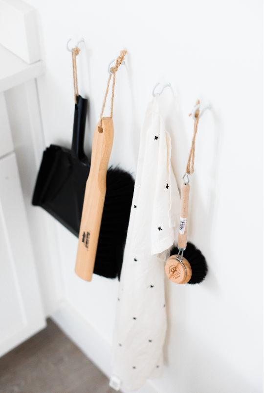 Hanging house cleaning tools in a clean home