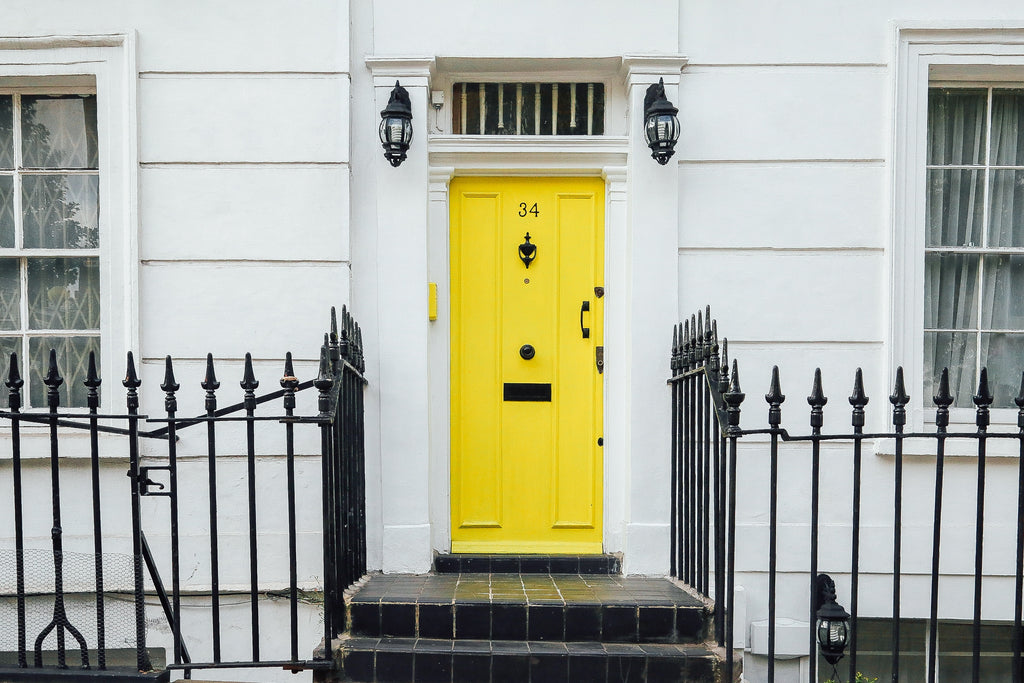 Stand out yellow door for a white home