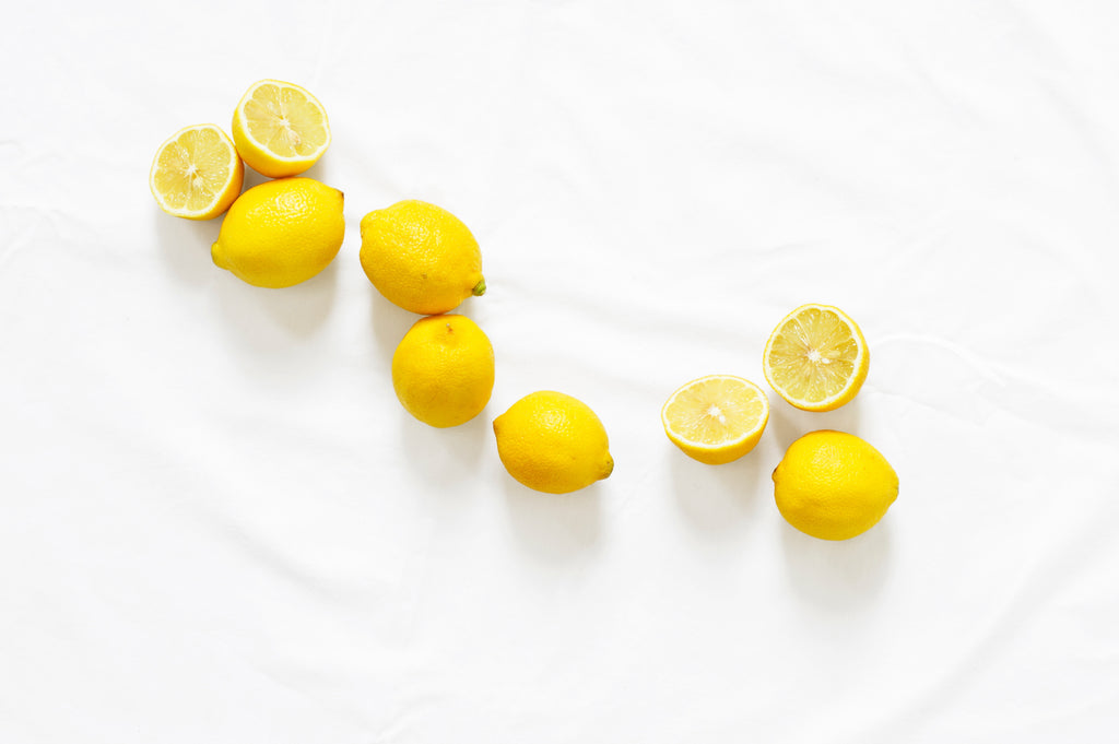 Fresh lemons on a white sheet