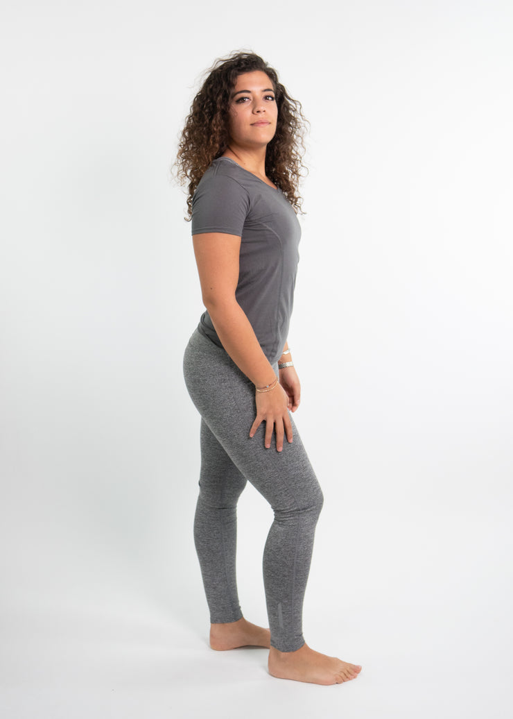 "Woman wearing gray motivational PGB Fit fitness T-shirt with gray PGB Fit fitness leggings that both say, ""Get Better"""
