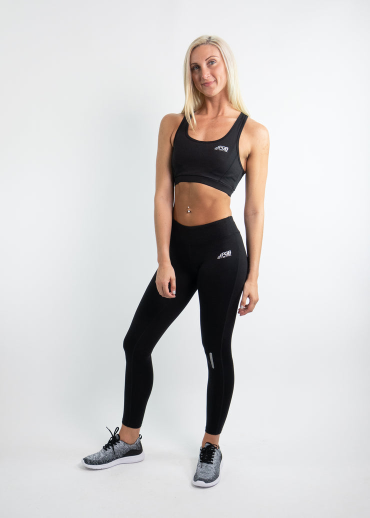 "Woman wearing black motivational PGB Fit fitness sports bra with black PGB Fit fitness leggings that both say, ""Get Better"""