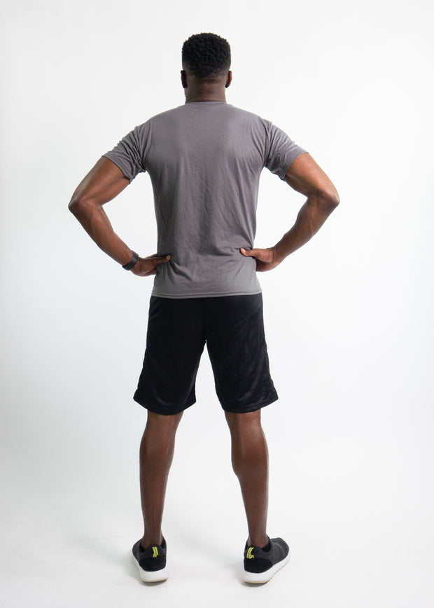 "Man wearing black motivational PGB Fit fitness shorts with gray PGB Fit fitness T-shirt that both say, ""Get Better"""