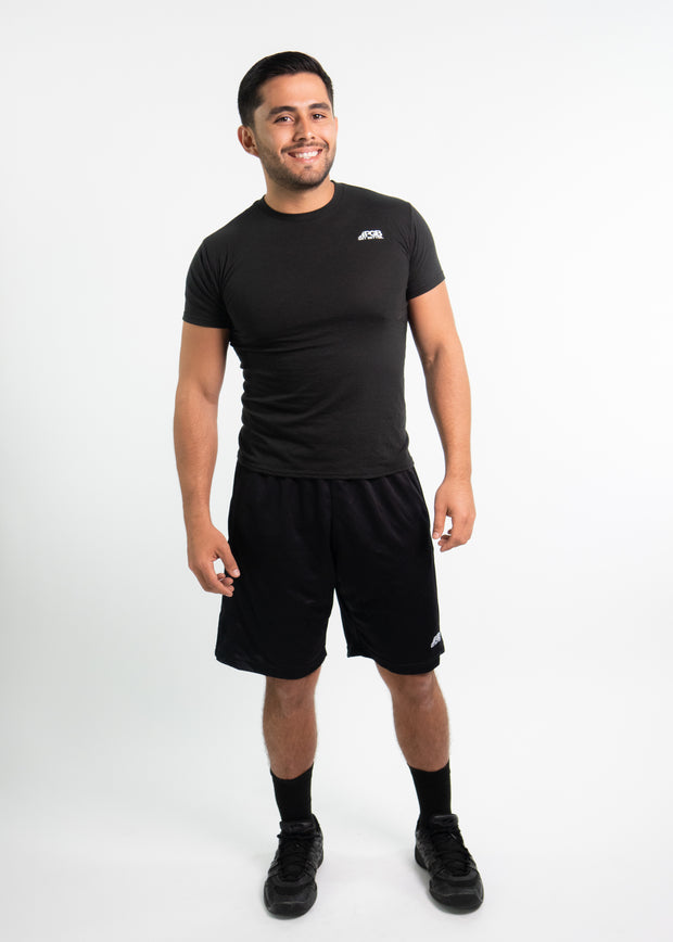 "Man wearing black motivational PGB Fit fitness T-shirt with black PGB Fit fitness shorts that both say, ""Get Better"""