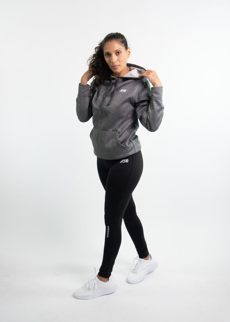 "Woman wearing gray motivational PGB Fit hoodie with black PGB Fit fitness leggings that both say, ""Get Better"""