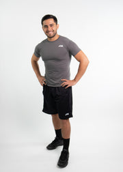 "Man wearing gray motivational PGB Fit fitness T-shirt with black PGB Fit fitness shorts that both say, ""Get Better"""