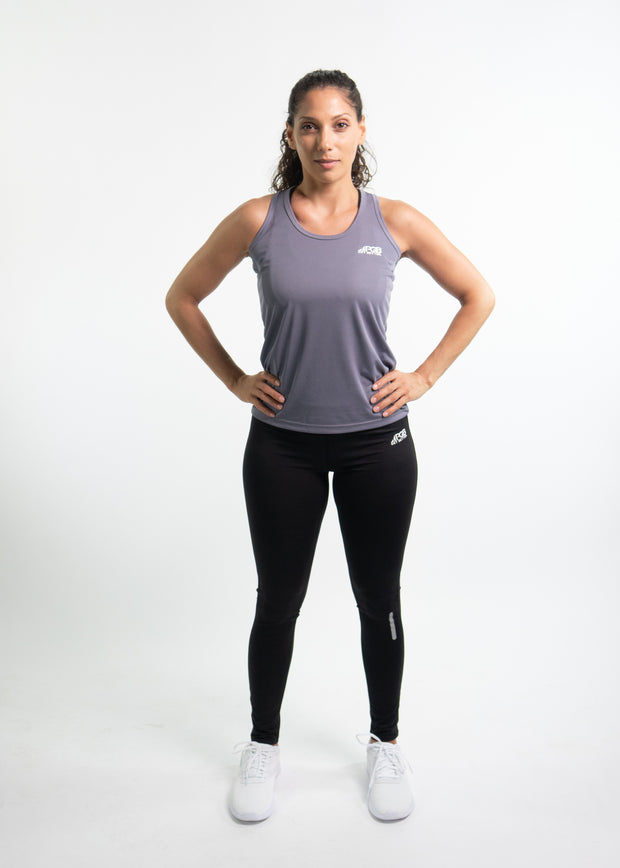 "Woman wearing gray motivational PGB Fit fitness racerback with black PGB Fit fitness leggings that both say, ""Get Better"""