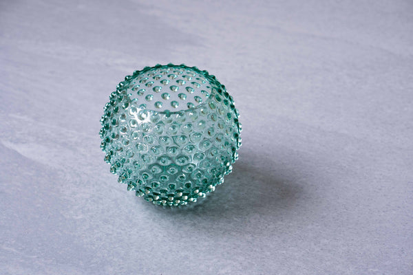 Beryl green Hobnail Glass Vase on the ground