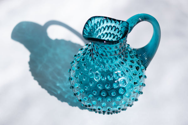Glass Aquamarine Hobnail Jug on the white Background