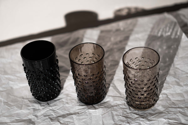 Black, Black Smoke and Underlay Black Smoke Hobnail Tumblers on the table