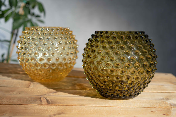 Hobnail Vase in Bonsai Green and in Citrine on a wooden table
