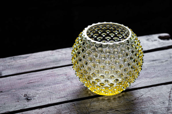 Citrine Hobnail Round Vase on a wooden floor