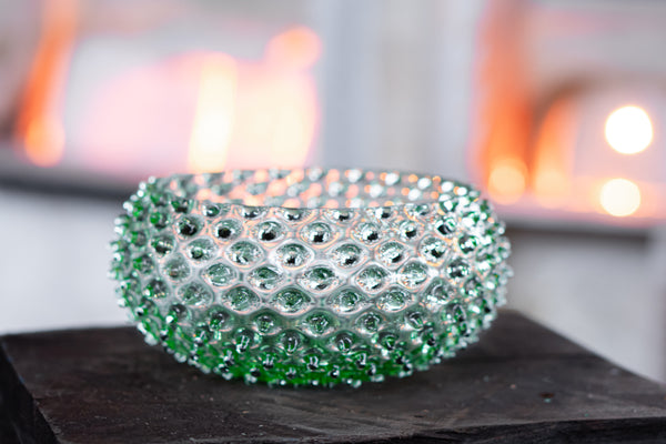 Light Green Bowl in front of glass furnace