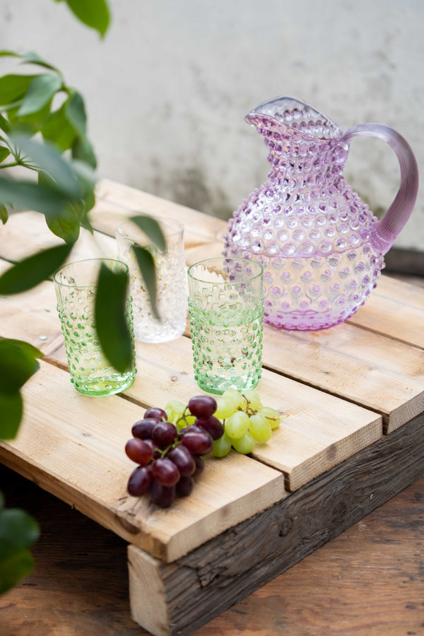 Two Light Green Hobnail Tumblers with grapes and Lilac Hobnail Jug on a wooden box