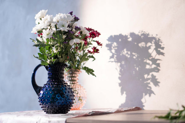 Royal Blue Hobnail Jug with a bouquet inside