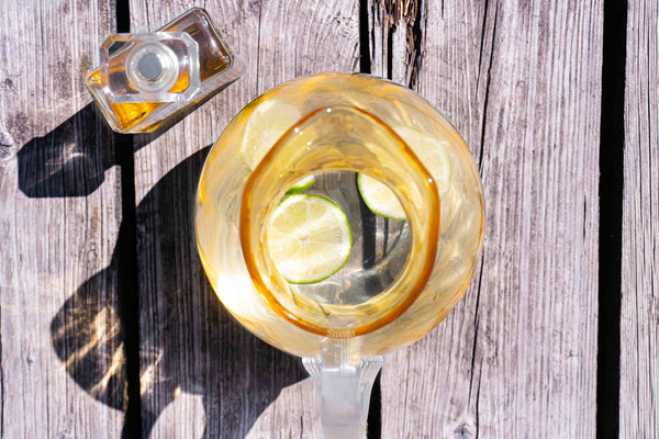 Marika Jug from above with water and lemons on a wooden floor