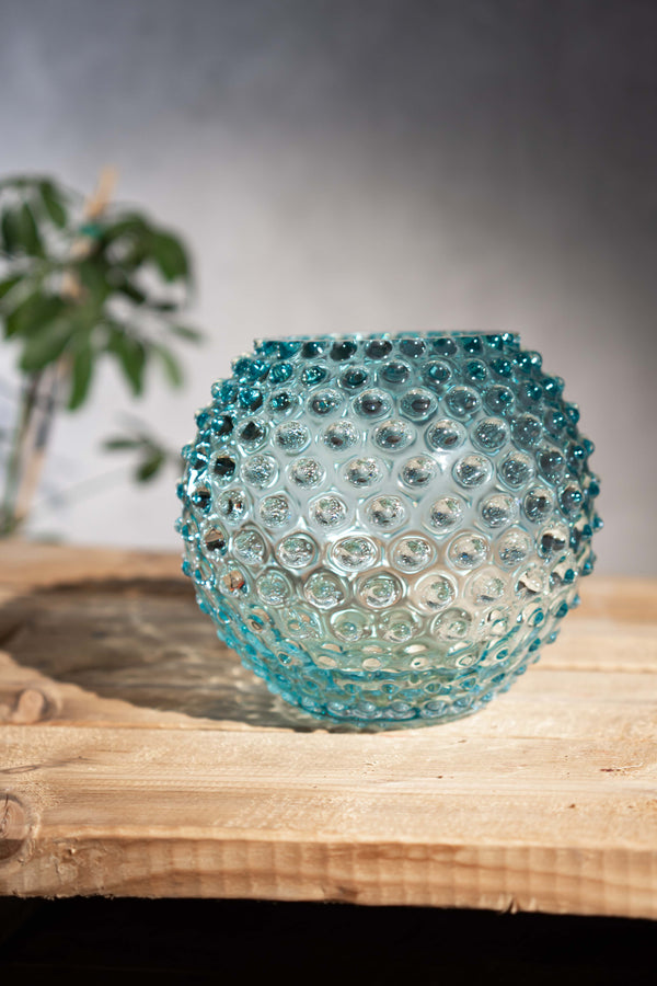 Hobnail Vase in Underlay Aquamarine on a wooden table
