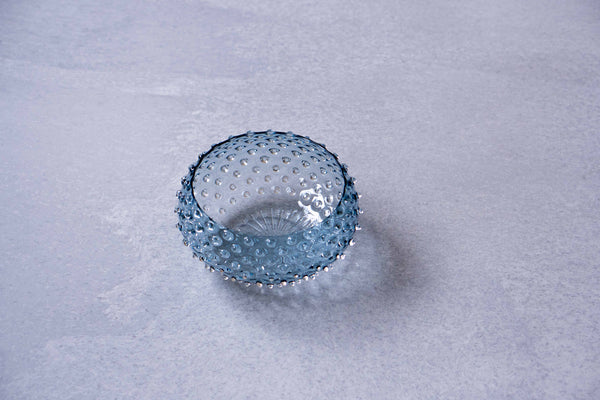 Underlay Blue Smoke Hobnail Bowl from above on a grey background