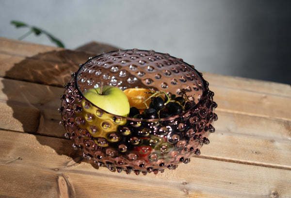 Hobnail Bowl filled with fruits on a wooden table