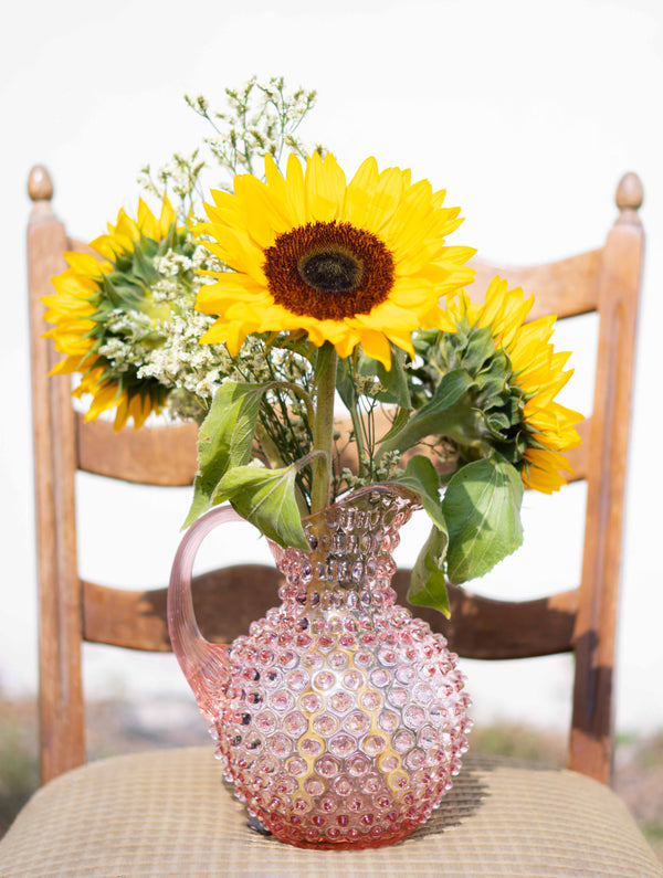 Rosaline Hobnail Jug with sunflowers inside standing on a chair