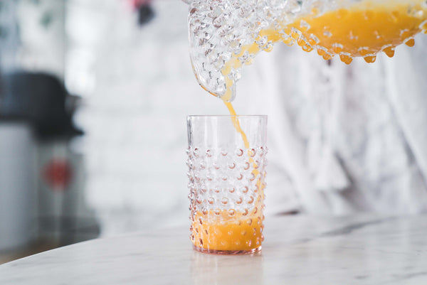 Rosaline Hobnail Tumbler with orange juice inside