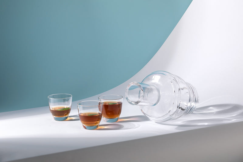 Cloudless Clear Carafe alongside Espresso Cup with ice-tea inside