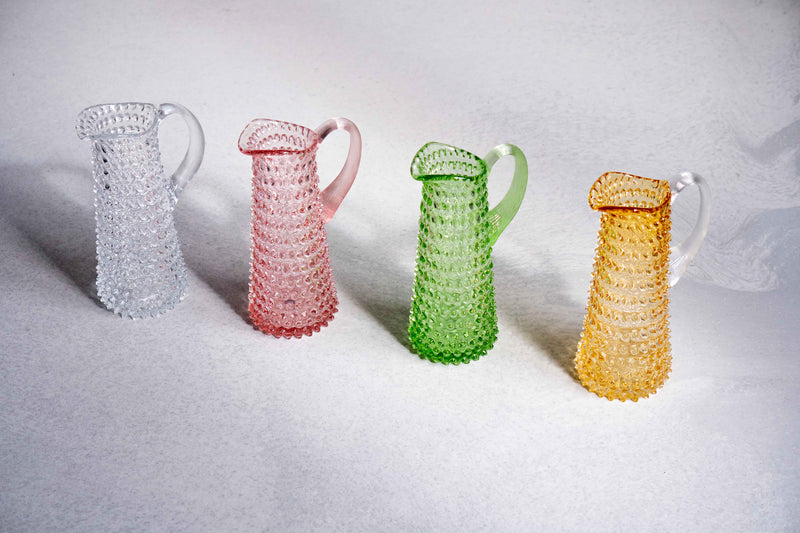 Four different colours of hobnail jugs tall