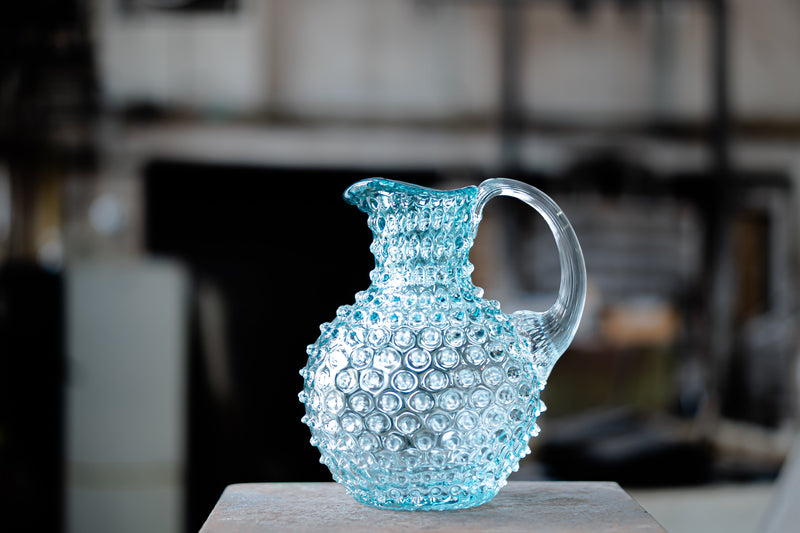 Taken photo of Underlay Aquamarine Hobnail Jug in the glass factory