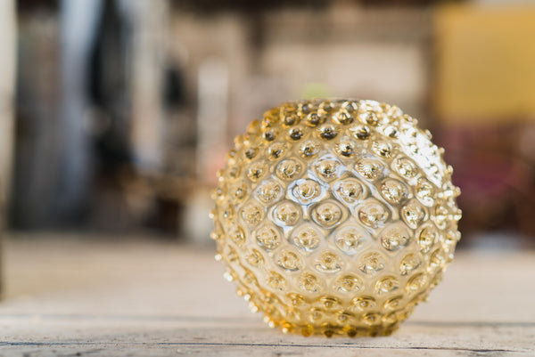 Focused photo of Underlay Amber Round Vase from Hobnail collection
