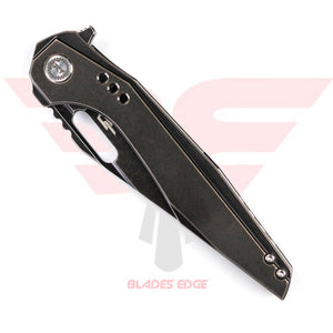 Bestech Malware BT1902B | Pocket Knife | Blades Edge - This manual flipper knife shown in the closed position, business side showing the black stonewash handle and blade along with the gold color pocket clip.