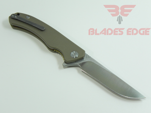 Civivi Knives Courser 804B | Pocket Knives| Folding Knives-Blades Edge, this knife show in the open position on the business side with tan G10 handle scales, titanium pocket clip and drop point style flat ground VG10 blade with a satin finish.