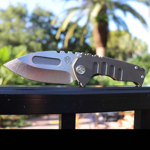 "Medford Knife and Tool - Praetorian Genesis T - Features bronze anodized titanum handle scales with glass breaker.  3.3"" Blade crafted from CPM S35VN Steel in a satin finish.  Excellent EDC choice.  Outside daylight view"