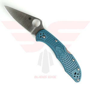 Spyderco Delica Pocket Knife Model - C11FPK390 features blue nylon handle with textured grip and K390 blade in a satin finish with a  full flat grind.  This is a manual open pocket knife with the trademark thumb hole.  Lock back type knife.