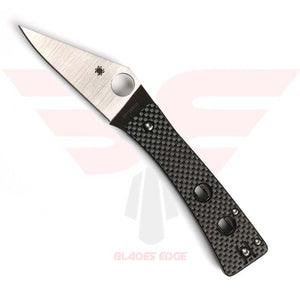 Spyderco Watu Compression Lock pocket knife features G10/Carbon Fiber handle scales with triangular shaped blade in a full flat grind made of CPM 20CV steel.  Trademark Spyderco thumb hole maual open and deep carr wire pocket clip.