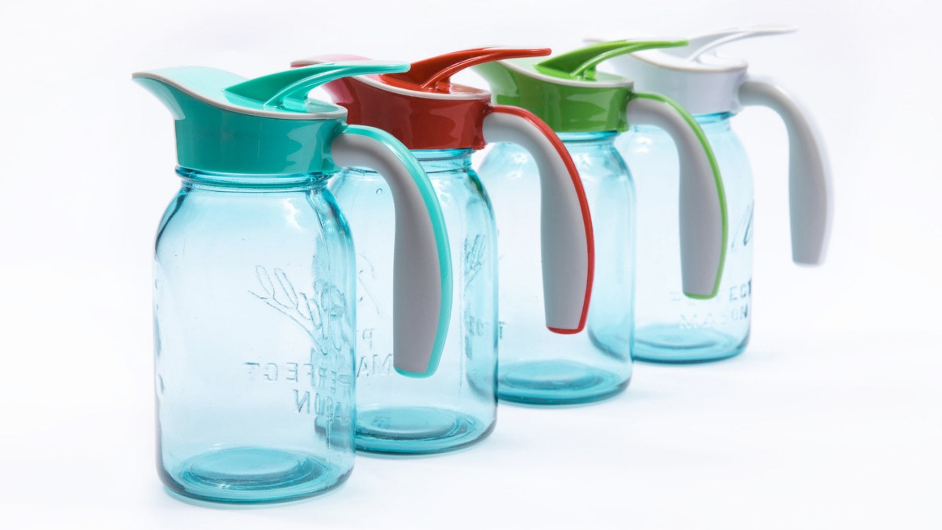 4 Ergo Spouts™ on vintage blue mason jars