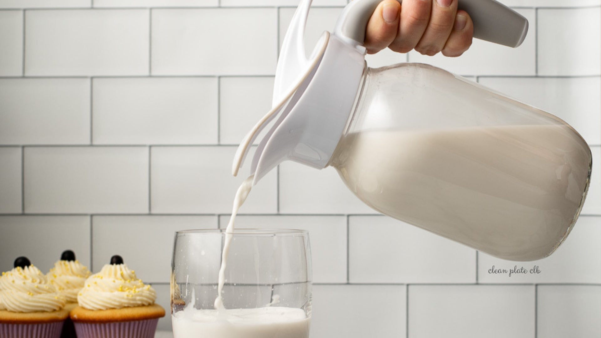 Ergo Spout™ pouring milk from a mason jar