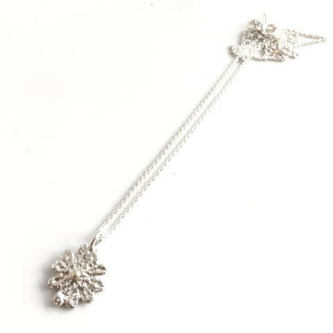 sterling silver and 14k gold cast lace pendant