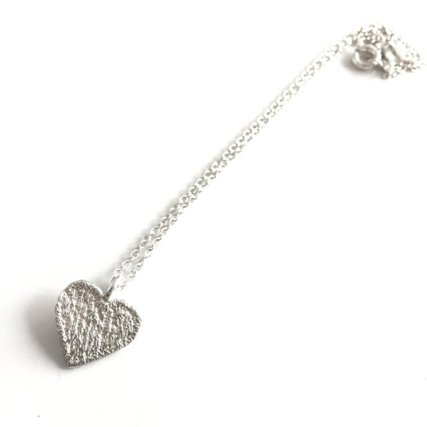 sterling silver cast lace heart pendant