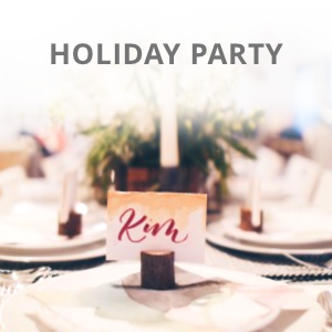 Holiday place setting with name card and holiday decorations