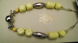 Primrose a bold pale  yellow necklace with large beads combines with silver tone for dramatic effect