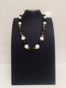 Black Tulip -a delightful black and white polka dots make a playful necklace design