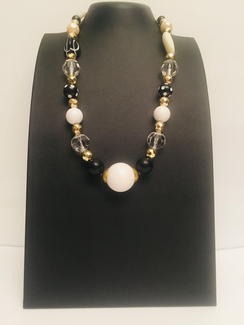 Black Tulip -a discreet black and white with translucent beads necklace has gold tones