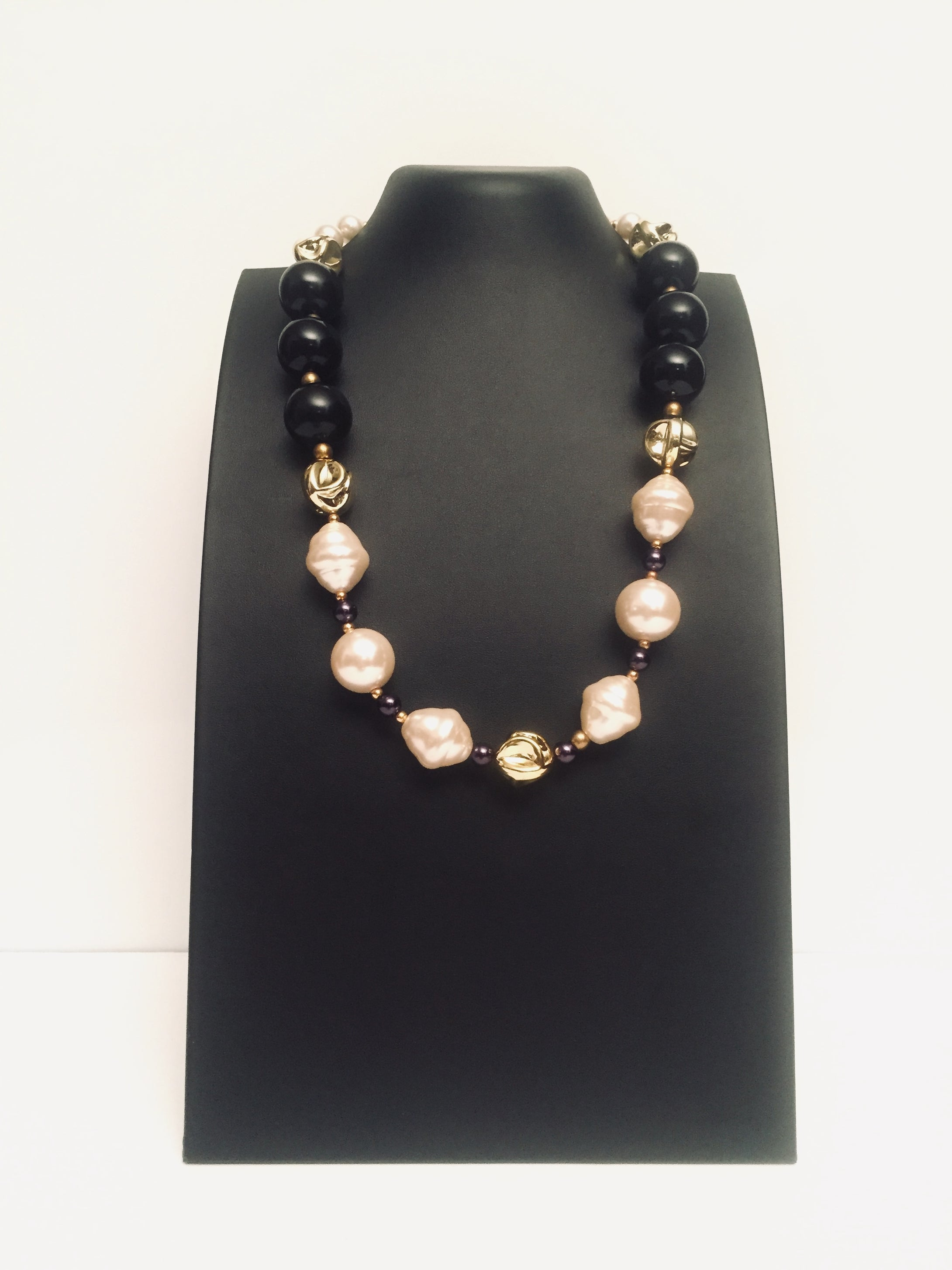 Black Tulip -a stunning black and  outsize  pearl necklace design with gold  tone