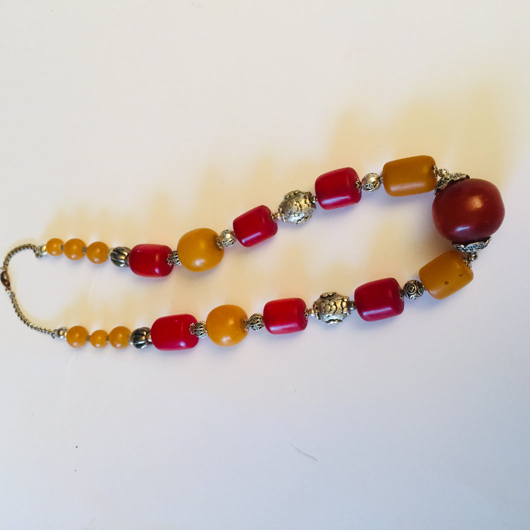 Amarillia amber necklace in warm red and yellow ochre colour with silver,