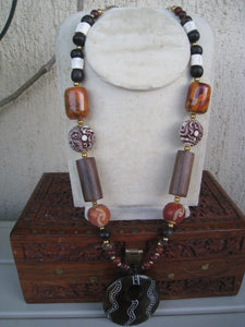 Andromeda long brown tones with russet brown and ivory and pendant with ethnic details