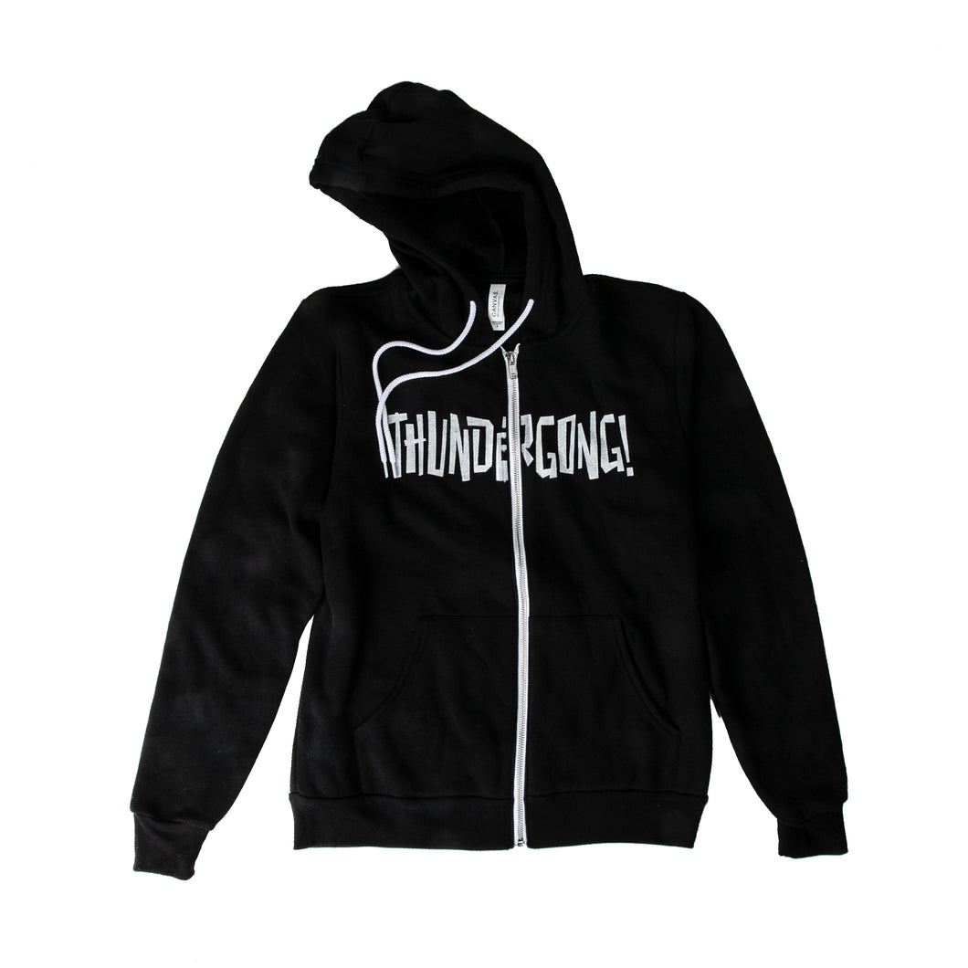 black hoodie with white thundergong! logo printed across the zipper