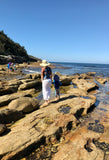 Caperly-Childrens-activities_mum_son_at_beach_exploring_rocks