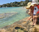 Caperly-Childrens-activities_Mother&son_pointing_at_rock_pools