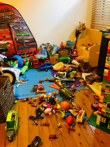 Too many toys all over the floor